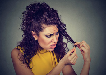 upset frustrated young woman surprised she is losing hair