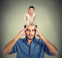 Stressed man with open head and screaming woman inside his brain