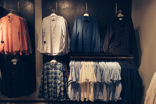 Shirts in men's clothing store. Shopping concept