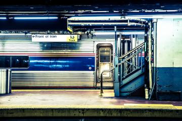 View of New York City train waiting at Long Island Railroad subway platform at Penn Station in Manhattan NYC.