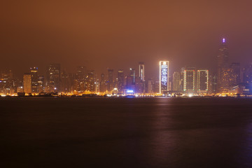 Buildings near the harbor bay in Hong Kong at night