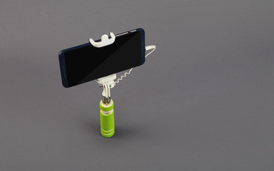 Selfie Stick with Mobile Phone Isolated on Gray Background
