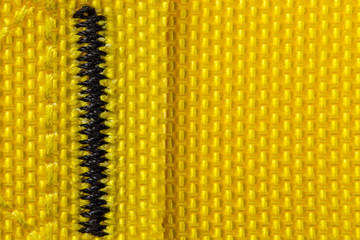 Close up of Yellow strap with black stitching