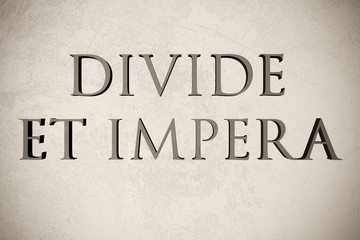 """Latin quote """"Divide et impera"""" on stone background, 3d illustration - meaning """"Divide and conquer"""""""
