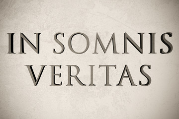 """Latin quote """"In somnis veritas"""" on stone background, 3d illustration - meaning """"In dreams there is truth"""""""