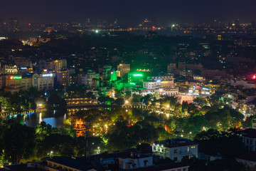 Aerial view of a corner of Hoan Kiem lake ( Sword lake, Ho Guom in Vietnamese ) at sunset time. Hanoi skyline view. Hoan Kiem lake is center of Hanoi