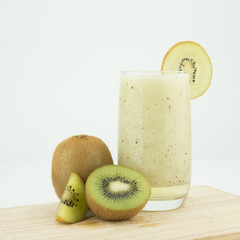 Wall Mural - Fresh kiwi smoothie in glass isolated on white
