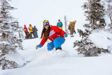 Girl snowboarder team group friends off-piste