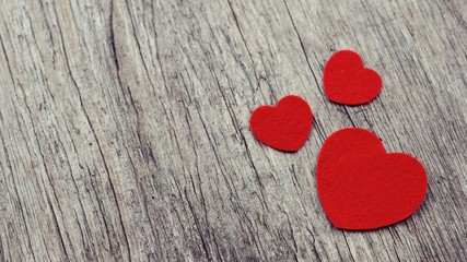 Red hearts on wooden background vintage style