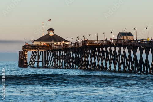 Fishermen on the imperial beach fishing pier at dawn in for San diego pier fishing