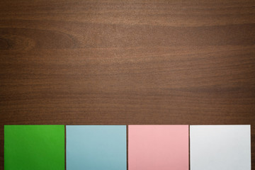 Color paper note on wooden background