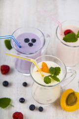 Smoothies or yogurt with fresh berries. Milkshakes with raspberr