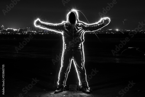 """""""Mystic black hooded man standing in the darkness ..."""