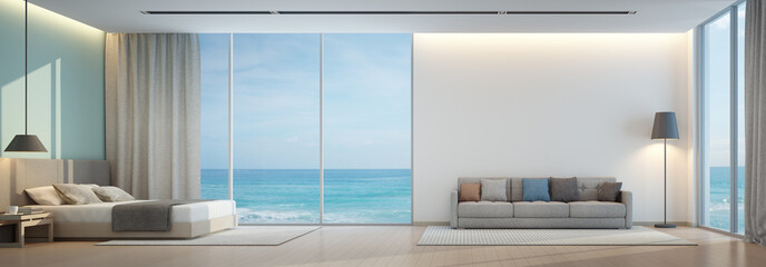 Wall Mural - Sea view bedroom and living room in luxury beach house - 3D rendering