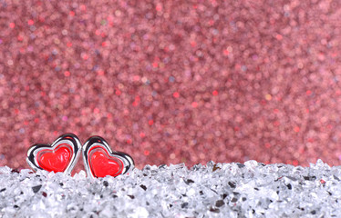 The red heart shapes on abstract light brown glitter background in love concept for valentines day and romantic moment