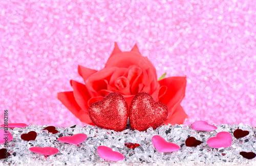The Red Heart Shapes And Red Rose Flower On Abstract Light Pink