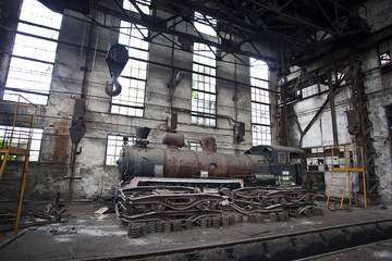 old locomotive in abandoned train factory