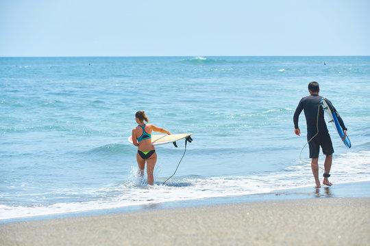 surf couple on a beach