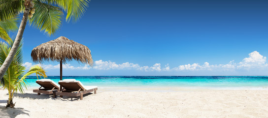 Tuinposter Strand Chairs And Umbrella In Tropical Beach - Seascape Banner