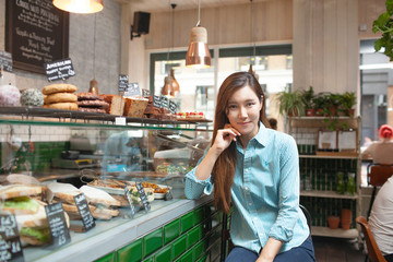 Portrait of mid adult woman in cafe