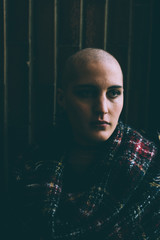 Portrait of young woman with shaved head