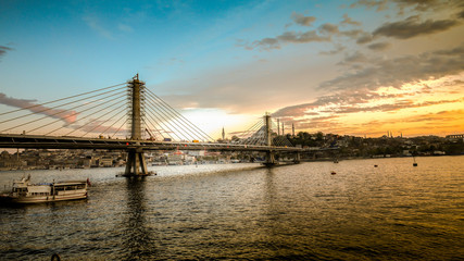 Istanbul, Turkey - April 13, 2013: Metro bridge through Golden Horn in Istanbul during sunset, Turkey