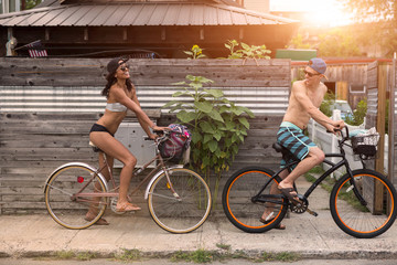 Young couple on bicycles, Rockaway Beach, New York State, USA