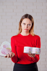 Young beautiful girl with Valentines day gift in heart shaped bo