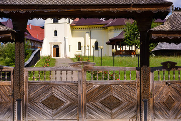 Orthodox monastery at gura humorului with wooden gates, suceava, romania