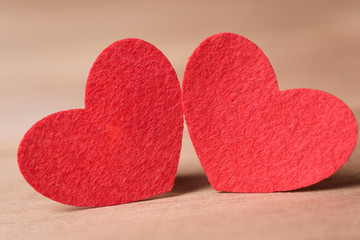 Valentines day concept of  two red heart shape cards with old wood floor background.