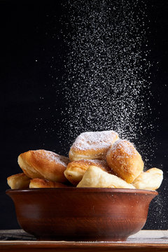 A plate of delicious sweet pies / pastries / donuts. Sopapilla is a traditional dish of cuisine Mexico / Belize. Sugar powder like snow. Beautiful photos of dessert for menu of the restaurant.