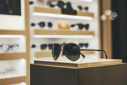 Elegant sunglasses in a fashion store showcase