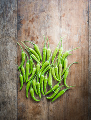 Green chili on an old wooden background