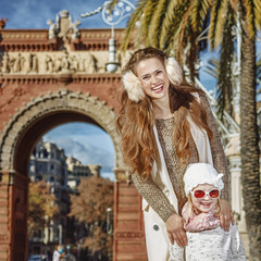 mother and daughter standing near Arc de Triomf