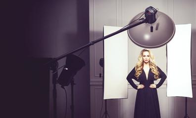 Beautiful, attractive model posing in a black dress