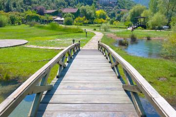 Park at open air restaurant in Montenegro. Wooden bridge across