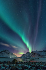 The Northern Lights over mountains in Norway.