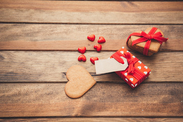 Gift box over wooden background. Heart shaped cookies for mothers day