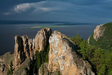 View of the great river with the high rocky shore. Lena river. Yakutia. Russia.