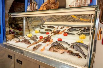 Fresh seafood served at Greek restaurant in Rethymno city on Crete island. Europe.