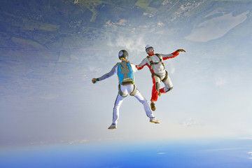 Two Skydivers Falling Upside Down
