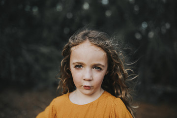 Portrait of girl standing in backyard