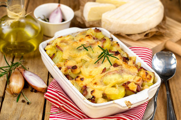 French dish Tartiflette with potatoes, reblochon cheese and baco
