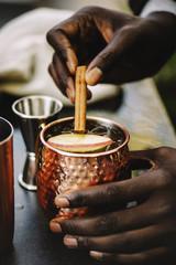 Cropped image of man making drink