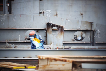 Worker working at shipyard