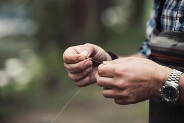Close up of man holding fishing thread