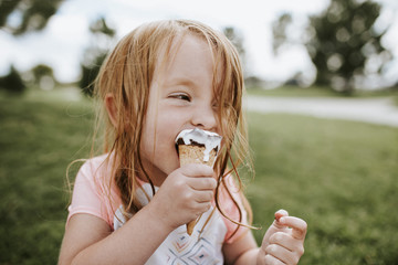 Close up of girl eating an ice cream outdoors