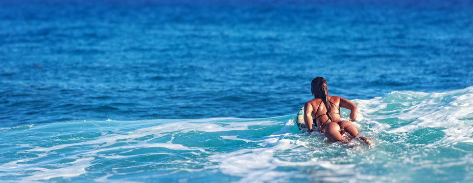 Surfer girl in Amazing Blue water