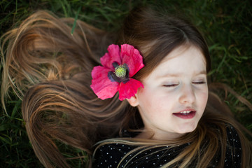 Portrait of young girl wearing flower hair clip
