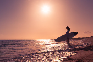 Female surfer on the beach.